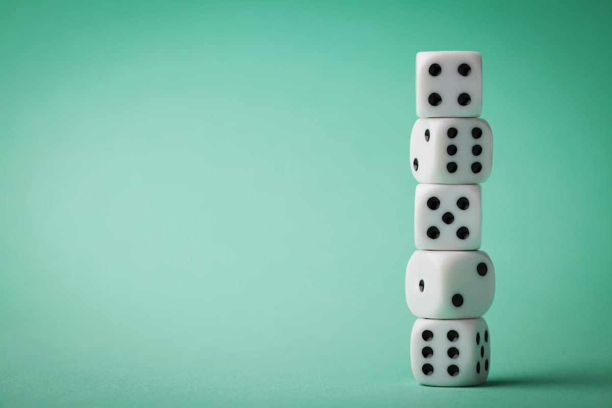 Photo of dice on bright green background.