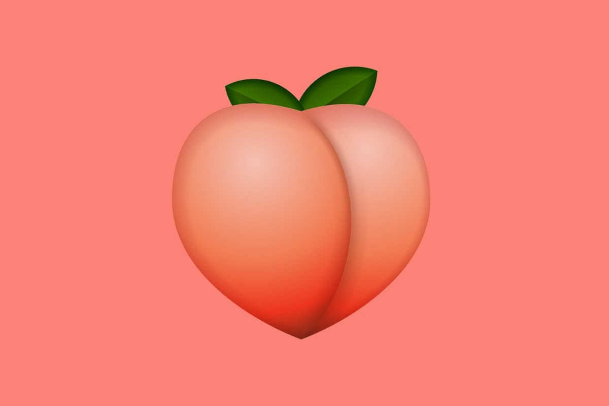 A large peach emoji against a peach-colored background.