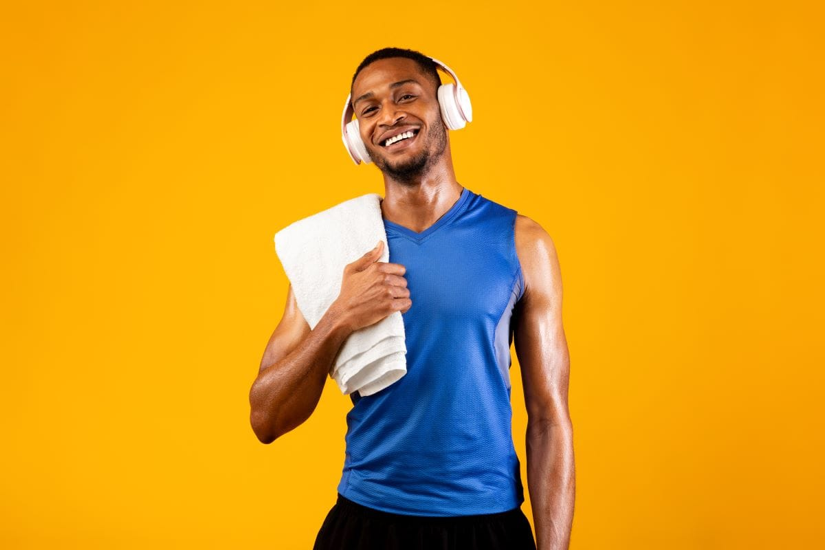 Handsome black man with headset and towel